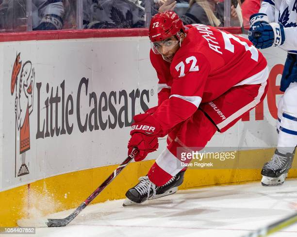 Andreas Athanasiou of the Detroit Red Wings controls the puck along the boards against the Toronto Maple Leafs during an NHL game at Little Caesars...