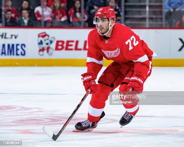 Andreas Athanasiou of the Detroit Red Wings follows the play against the Vancouver Canucks during an NHL game at Little Caesars Arena on October 22...