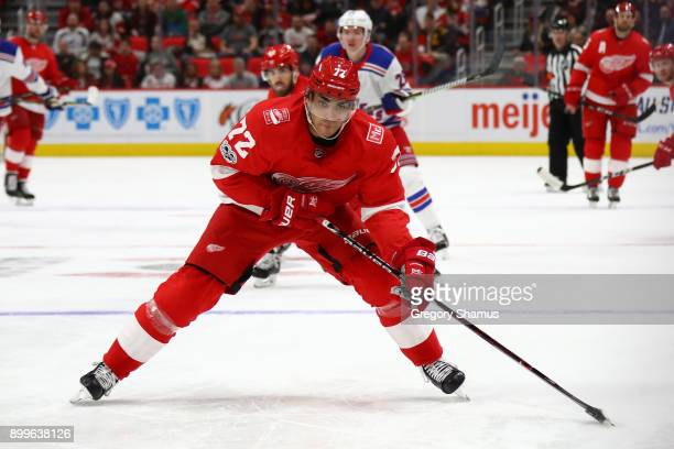 Andreas Athanasiou of the Detroit Red Wings looks for a second period shot while playing the New York Rangers at Little Caesars Arena on December 29...