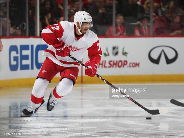 Andreas Athanasiou of the Detroit Red Wings plays the puck against the New Jersey Devils during the game at Prudential Center on November 17 2018 in...