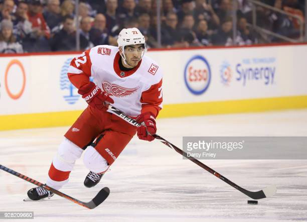 Andreas Athanasiou of the Detroit Red Wings plays the puck down the ice during third period action against the Winnipeg Jets at the Bell MTS Place on...