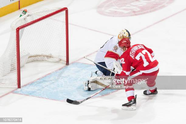 Andreas Athanasiou of the Detroit Red Wings scores a first period goal past goaltender Roberto Luongo of the Florida Panthers during an NHL game at...
