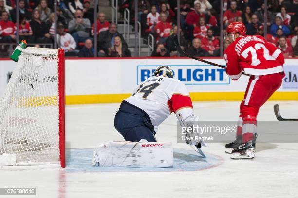 Andreas Athanasiou of the Detroit Red Wings scores a goal past goaltender James Reimer of the Florida Panthers The goal was overturned by video...