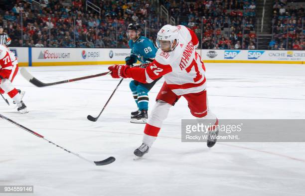 Andreas Athanasiou of the Detroit Red Wings shoots the puck against the San Jose Sharks at SAP Center on March 12 2018 in San Jose California Andreas...