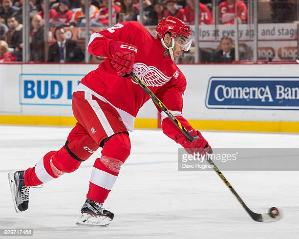 Andreas Athanasiou of the Detroit Red Wings shoots the puck during an NHL game against the Philadelphia Flyers at Joe Louis Arena on December 11 2016...