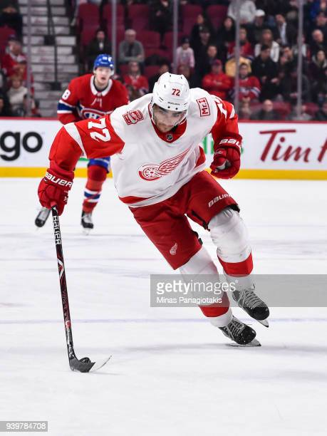 Andreas Athanasiou of the Detroit Red Wings skates the puck against the Montreal Canadiens during the NHL game at the Bell Centre on March 26 2018 in...