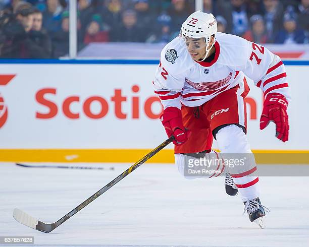 Andreas Athanasiou of the Detroit Red Wings skates up ice against the Toronto Maple Leafs during the 2017 Scotiabank NHL Centennial Classic at...