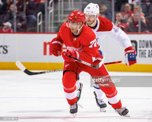 Andreas Athanasiou of the Detroit Red Wings skates up ice in front of Joel Armia of the Montreal Canadiens during an NHL game at Little Caesars Arena...