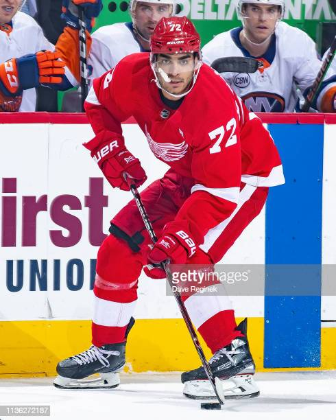 Andreas Athanasiou of the Detroit Red Wings skates up ice with the puck against the New York Islanders during an NHL game at Little Caesars Arena on...