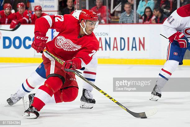 Andreas Athanasiou of the Detroit Red Wings skates up ice with the puck during an NHL game against the Montreal Canadiens at Joe Louis Arena on March...