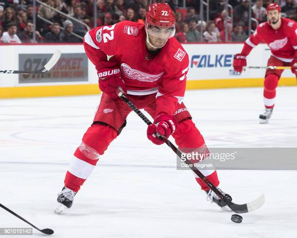 Andreas Athanasiou of the Detroit Red Wings skates with the puck during an NHL game against the Ottawa Senators at Little Caesars Arena on January 3...