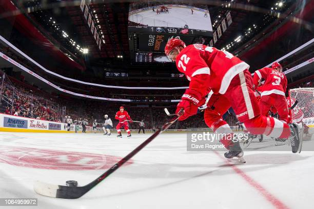 Andreas Athanasiou of the Detroit Red Wings skates with the puck along the boards during an NHL game against the Buffalo Sabres at Little Caesars...