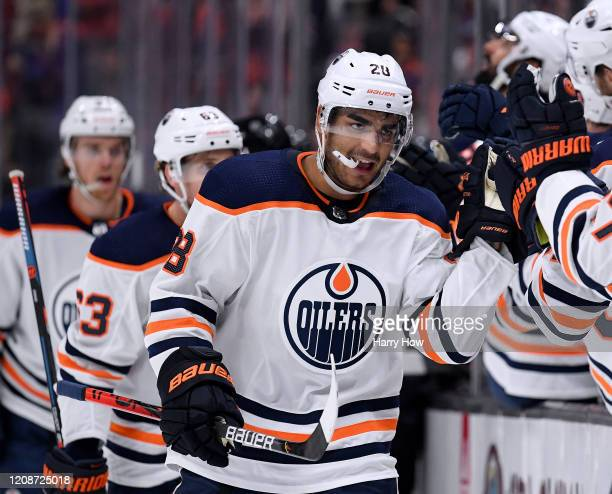 Andreas Athanasiou of the Edmonton Oilers celebrates his goal with the bench to tie the game 33 with the Anaheim Ducks during the third period in a...
