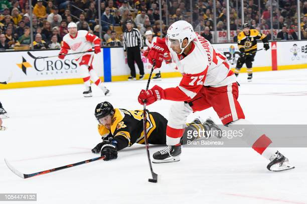 Andreas Athanasiou the Detroit Red Wings shoots against the Boston Bruins at the TD Garden on October 13 2018 in Boston Massachusetts