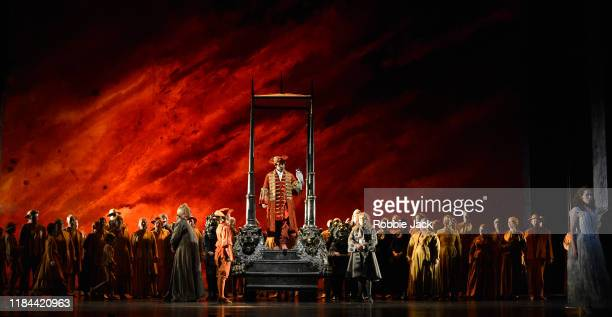 Andreas Bauer Kanabas as Sarastro and Elsa Dreisig as Pamina with artists of the company in The Royal Opera's Production of Wolfgang Amadeus Mozart's...