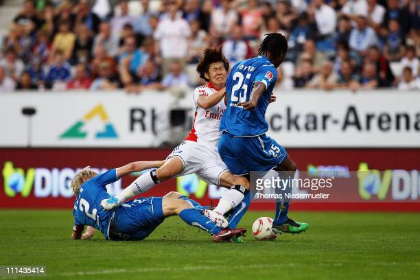 Andreas Beck and Isaac Vorsah of Hoffenheim fight for the ball with Heung Min Son of Hamburg during the Bundesliga match between TSG 1899 Hoffenheim...