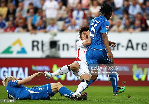 Andreas Beck and Isaac Vorsah of Hoffenheim fights for the ball with Heung Min Son of Hamburg during the Bundesliga match between TSG 1899 Hoffenheim...