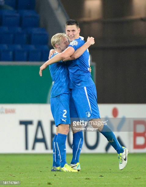 Andreas Beck and Niklas Suehle celebrates after scoring her teams opening goal during the DFB Cup second round match between TSG 1899 Hoffenheim and...