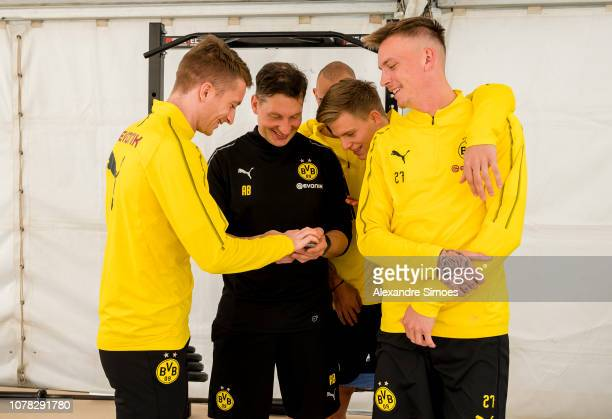 Andreas Beck athletic coach of Borussia Dortmund joke with Marco Reus Dzenis Burnic and Marius Wolf during a training session as part of the training...