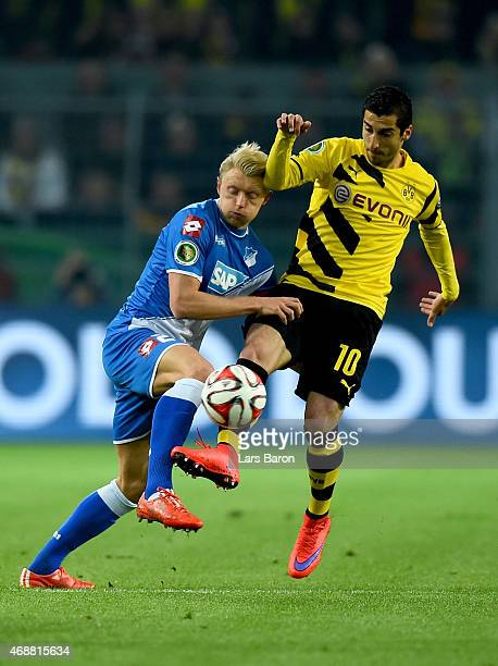 Andreas Beck of 1899 Hoffenheim challenges Henrikh Mkhitaryan of Borussia Dortmund during the DFB Cup Quarter Final match between at Borussia...
