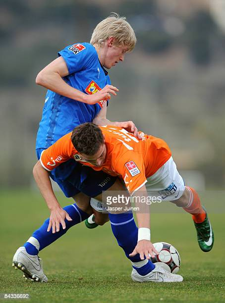 Andreas Beck of 1899 Hoffenheim duels for the ball with Marco Schonbachler of FC Zuerich during the friendly match between 1899 Hoffenheim and FC...