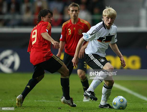 Andreas Beck of Germany and Bojan Krkic of Spain battle for the ball during the UEFA U21 Championship Group B match between Spain and Germany at the...