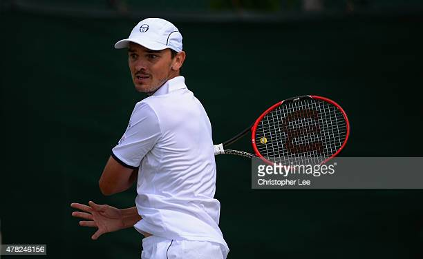 Andreas Beck of Germany in action against Andrey Kuznetsov of Russia in the Gentlemens Second round match during the 2015 Wimbledon Qualifying...