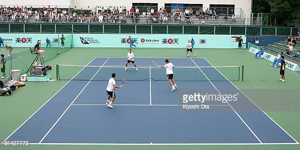 Andreas Beck of Germany returns a shot with his partner Philipp Petzschner of Germany in their doubles match against Frantisek Cermak of the Czech...
