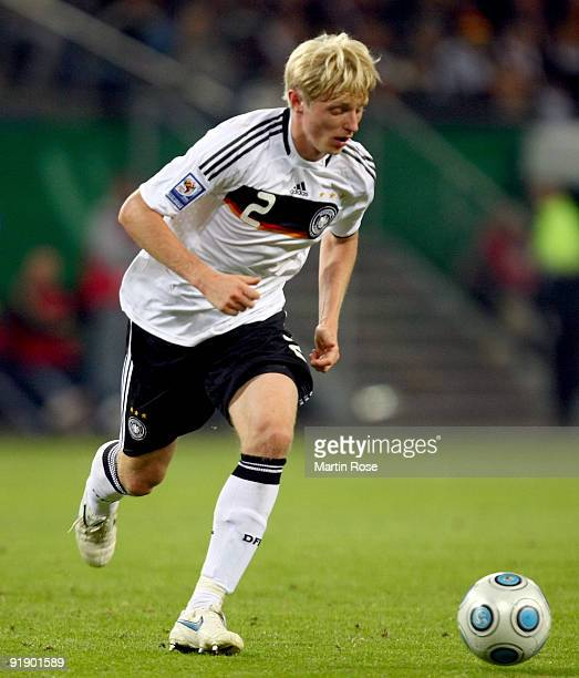 Andreas Beck of Germany runs with the ball during the FIFA 2010 World Cup Group 4 Qualifier match between Germany and Finland at the Hamburg Arena on...