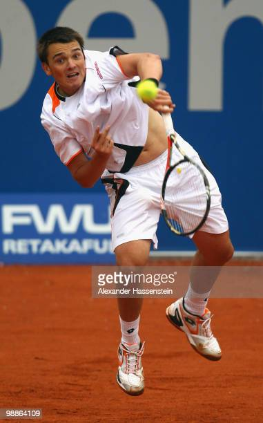 Andreas Beck of Germany serves the ball during his match against Mikhail Youzhny of Russia at day 4 of the BMW Open at the Iphitos tennis club on May...