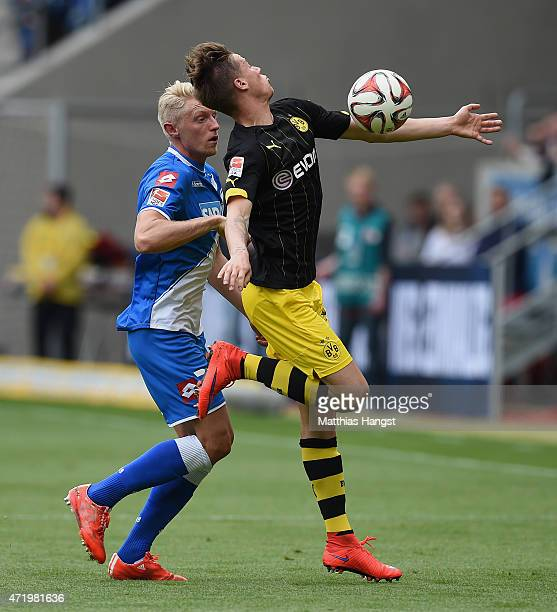 Andreas Beck of Hoffenheim and Erik Durm of Dortmund gestures during the Bundesliga match between 1899 Hoffenheim and Borussia Dortmund at Wirsol...