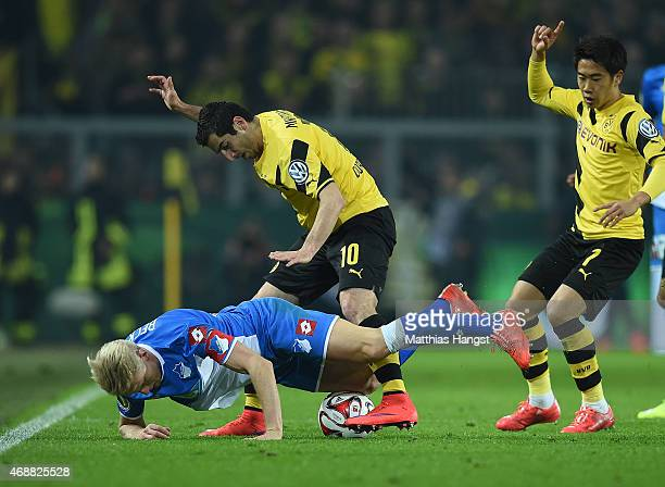 Andreas Beck of Hoffenheim and Henrikh Mkhitaryan of Dortmund compete for the ball during the DFB Cup Quarter Final match between Borussia Dortmund...