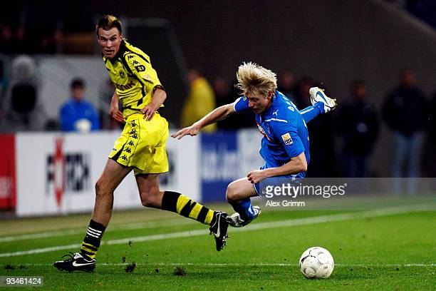 Andreas Beck of Hoffenheim and Kevin Grosskreutz of Dortmund battle for the ball during the Bundesliga match between 1899 Hoffenheim and Borussia...