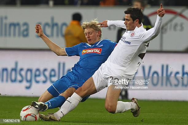 Andreas Beck of Hoffenheim battles for the ball with Fin Bartels of St. Pauli during the Bundesliga match between 1899 Hoffenheim and FC St. Pauli at...