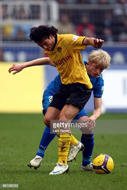 Andreas Beck of Hoffenheim challenges Nelson Valdez of Dormtund during the Bundesliga match between Borussia Dortmund and 1899 Hoffenheim at the...