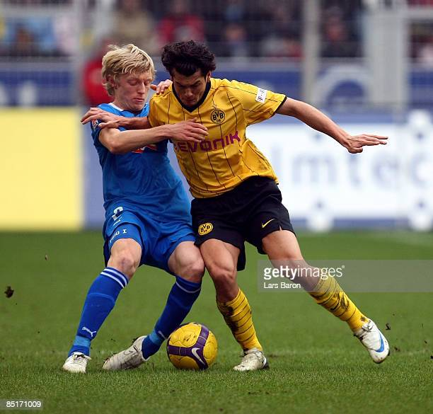 Andreas Beck of Hoffenheim challenges Nelson Valdez of Dortmund during the Bundesliga match between Borussia Dortmund and 1899 Hoffenheim at the...