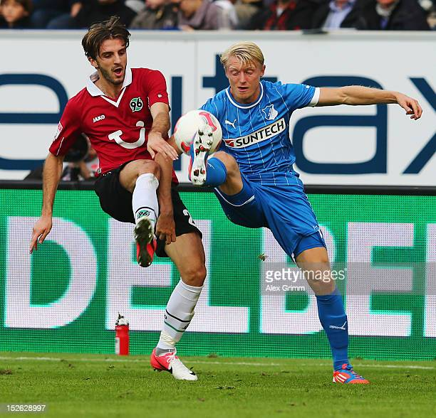 Andreas Beck of Hoffenheim is challenged by Adrian Nikci of Hannover during the Bundesliga match between 1899 Hoffenheim and Hannover 96 at...