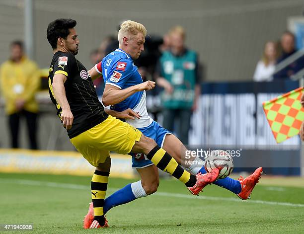 Andreas Beck of Hoffenheim is challenged by Ilkay Guendogan of Dortmund during the Bundesliga match between 1899 Hoffenheim and Borussia Dortmund at...