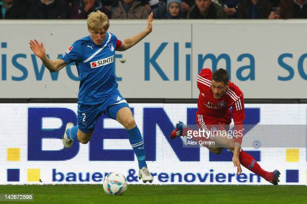 Andreas Beck of Hoffenheim is challenged by Ivo Ilicevic of Hamburg during the Bundesliga match between 1899 Hoffenheim and Hamburger SV at...