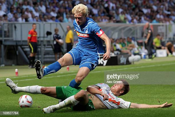 Andreas Beck of Hoffenheim is challenged by Philipp Bargfrede of Bremen during the Bundesliga match between 1899 Hoffenheim and Werder Bremen at the...