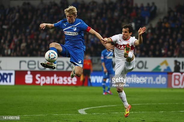 Andreas Beck of Hoffenheim is challenged by Tamas Hajnal of Stuttgart during the Bundesliga match between 1899 Hoffenheim and VfB Stuttgart at...