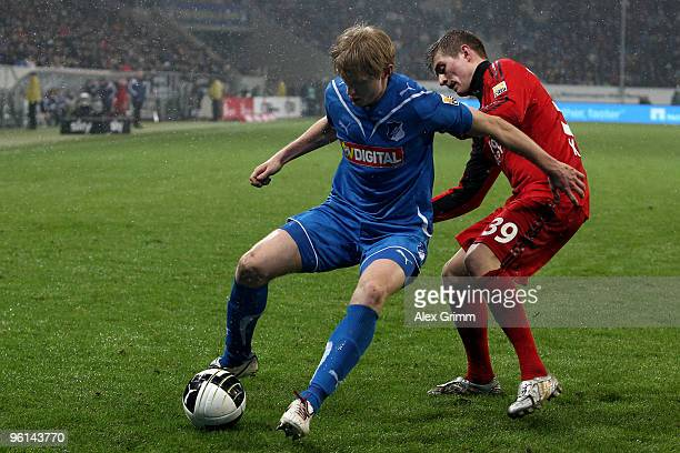 Andreas Beck of Hoffenheim is challenged by Toni Kroos of Leverkusen during the Bundesliga match between 1899 Hoffenheim and Bayer Leverkusen at the...