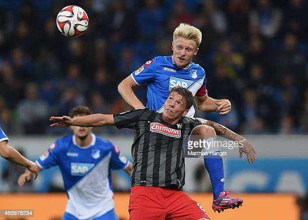 Andreas Beck of Hoffenheim jumps for a header with Mike Frantz of Freiburg during the Bundesliga match between TSG 1899 Hoffenheim and SC Freiburg at...