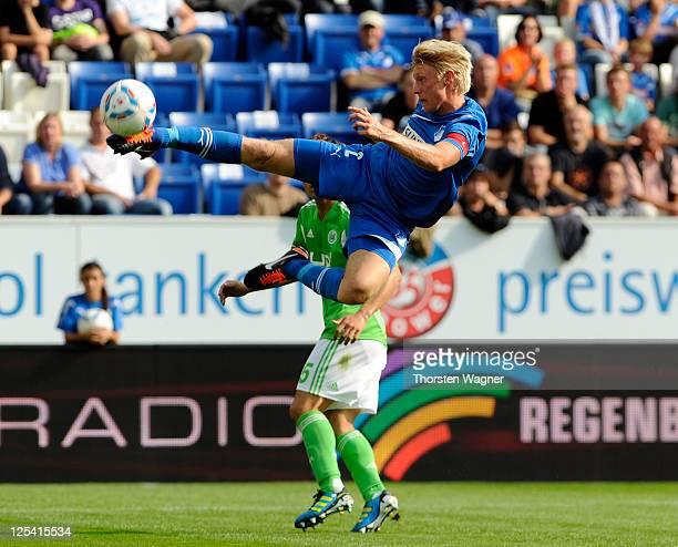 Andreas Beck of Hoffenheim kicks the ball during the Bundesliga match between TSG 1899 Hoffenheim and VFL Wolfsburg at RheinNeckarArena on September...