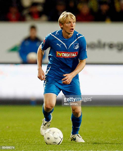 Andreas Beck of Hoffenheim runs with the ball during the Bundesliga match between 1899 Hoffenheim and Borussia Dortmund at the RheinNeckar Arena on...