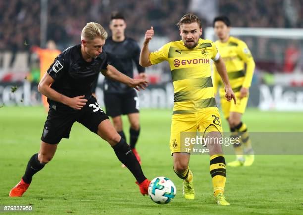 Andreas Beck of Stuttgart and Marcel Schmelzer of Dortmund battle for the ball during the Bundesliga match between VfB Stuttgart and Borussia...