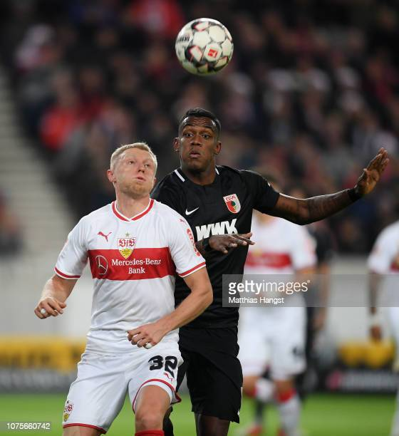 Andreas Beck of Stuttgart and Sergio Cordova of Augsburg compete for the ball during the Bundesliga match between VfB Stuttgart and FC Augsburg at...