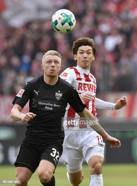 Andreas Beck of Stuttgart and Yuya Osako of Koeln battle for the ball during the Bundesliga match between 1 FC Koeln and VfB Stuttgart at...