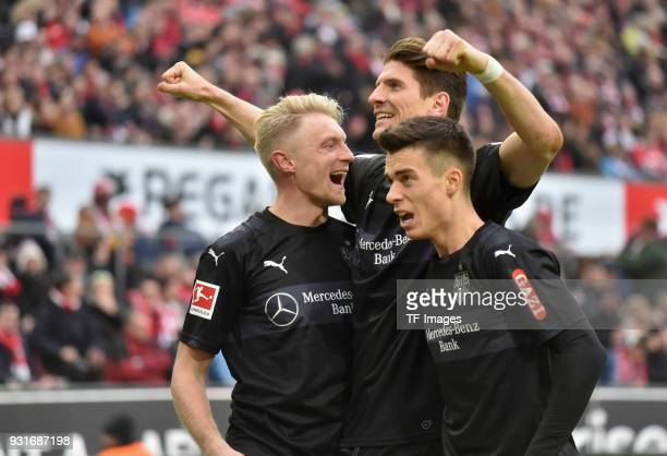 Andreas Beck of Stuttgart celebrates after scoring his team`s third goal with Erik Thommy of Stuttgart and Mario Gomez of Stuttgart during the...