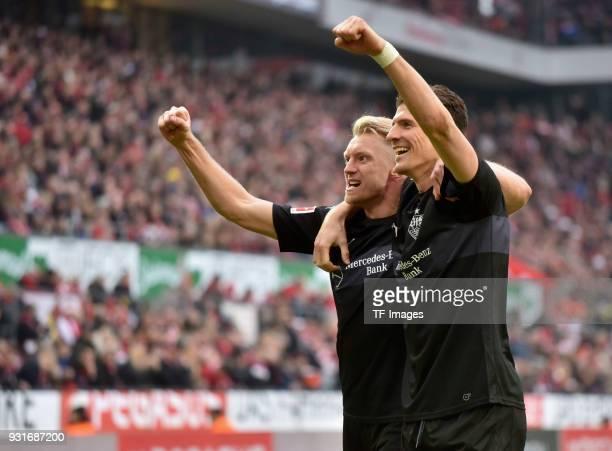 Andreas Beck of Stuttgart celebrates after scoring his team`s third goal with Mario Gomez of Stuttgart during the Bundesliga match between 1 FC Koeln...